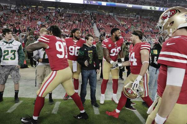 a3c24ec6e 3of4Players from the San Francisco 49ers high-five football players from  Paradise High School at Levi s Stadium before the San Francisco 49ers  played the ...