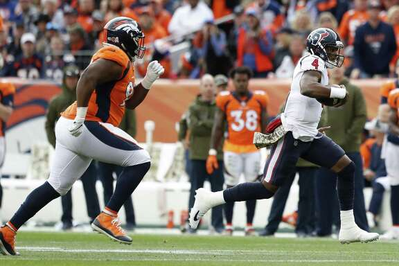 Houston Texans quarterback Deshaun Watson (4) runs past Denver Broncos defensive end Zach Kerr (92) as he is forced out of the pocket during the first quarter of an NFL football game at Broncos Stadium at Mile High on Sunday, Nov. 4, 2018, in Denver.