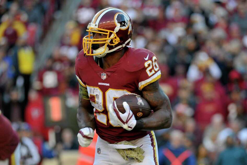 Washington Redskins running back Adrian Peterson runs the ball during an NFL football game against the Atlanta Falcons, Sunday, Nov. 4, 2018, in Landover, Md. (AP Photo/Mark Tenally)