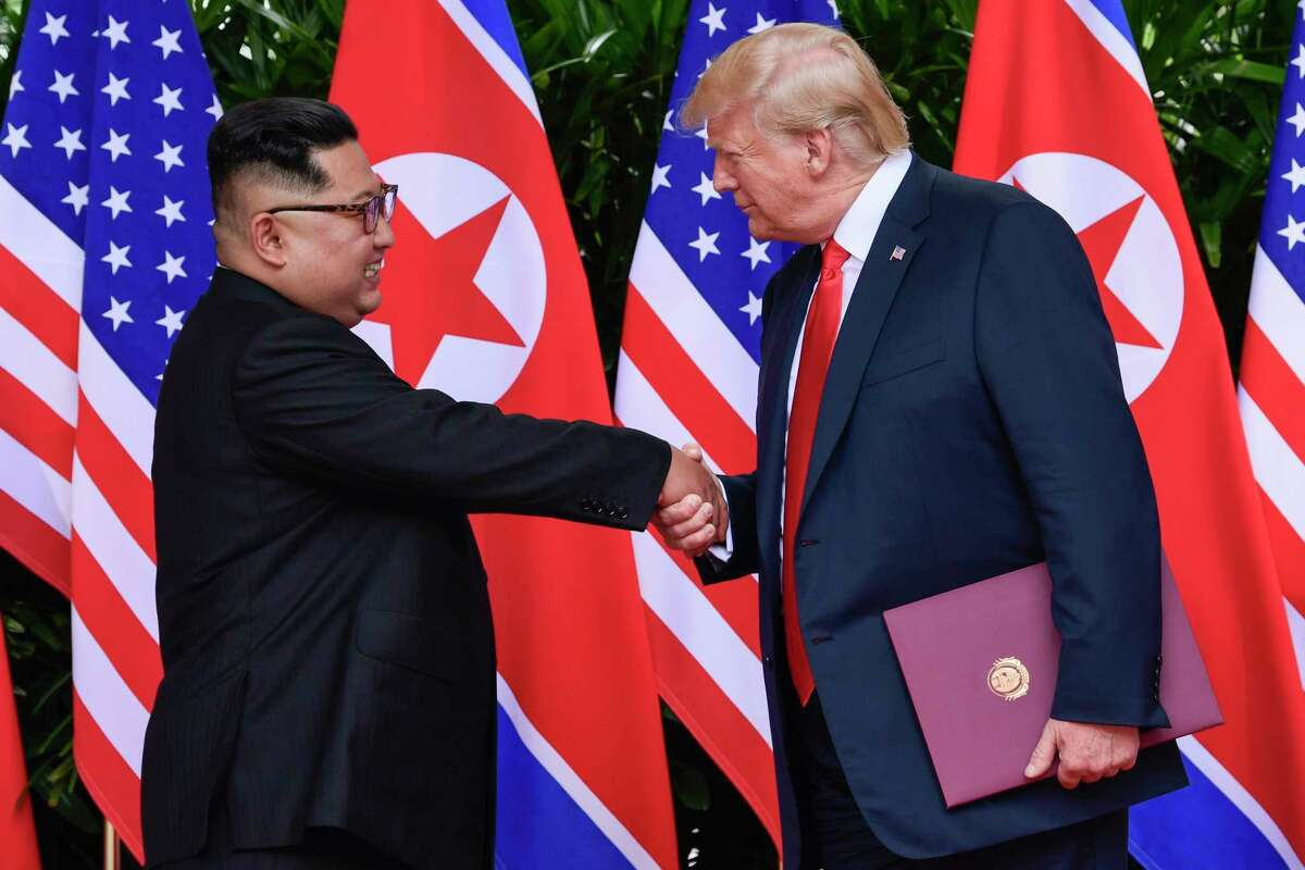 FILE - In this June 12, 2018, file photo, North Korean leader Kim Jong Un, left, and U.S. President Donald Trump shake hands at the conclusion of their meetings at the Capella resort on Sentosa Island in Singapore. U.S. analysts say they have located more than half of an estimated 20 secret North Korean missile development facilities. The findings come as the Trump administration?'s denuclearization talks with the North appear to have stalled. And they highlight the challenge the U.S. faces in ensuring that North Korea complies with any eventual agreement that covers its nuclear and missile programs. (AP Photo/Susan Walsh, Pool, File)
