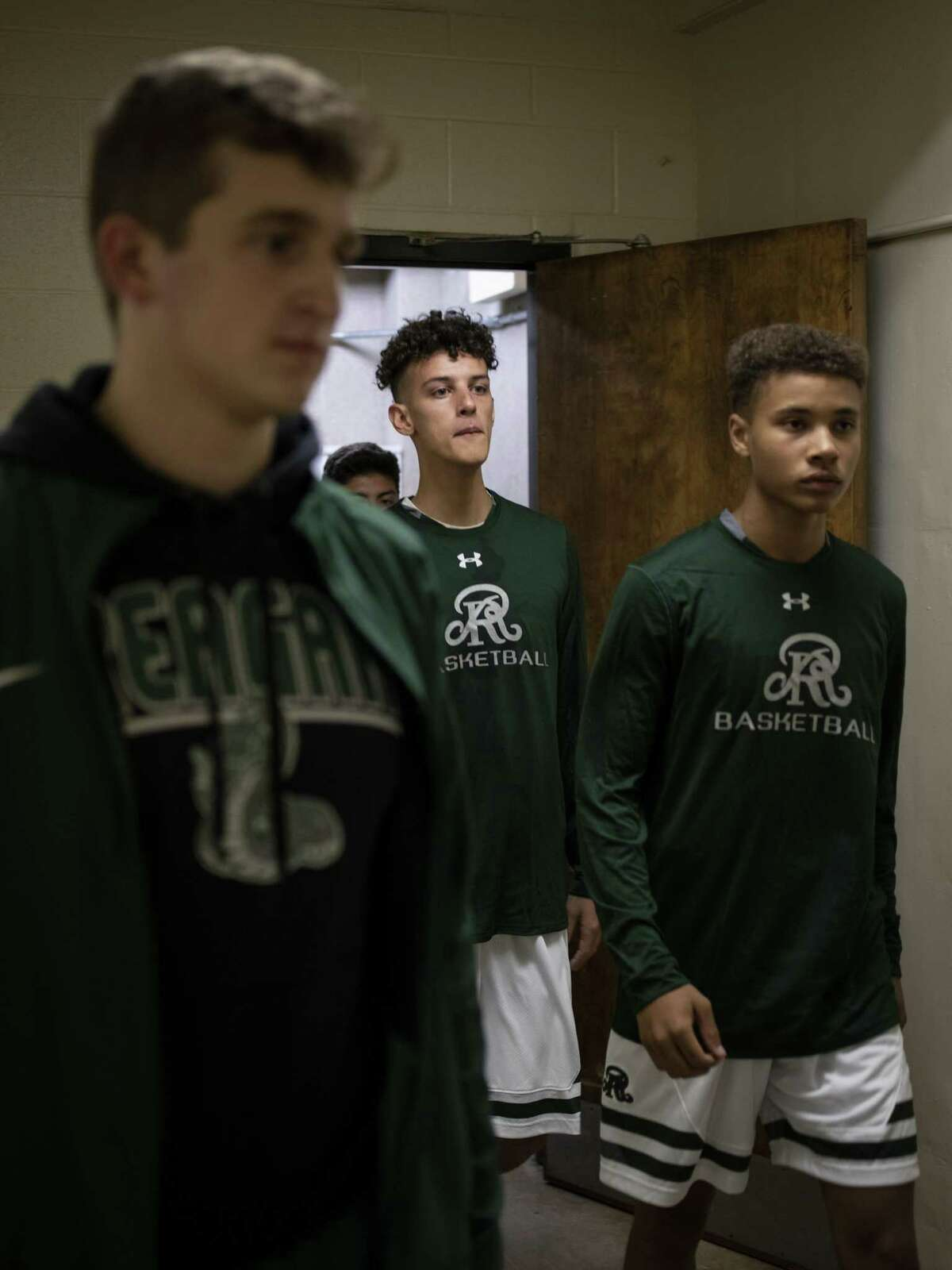 Senior Kaeyel Moore, no. 22, exits the locker room and returns to the basketball court for the Reagan High School Rattlers on Monday, November 12, 2018. Moore suffered a cardiac arrest on the practice gym 10 months ago. Head coach John Hirst said that it's good to have him back.