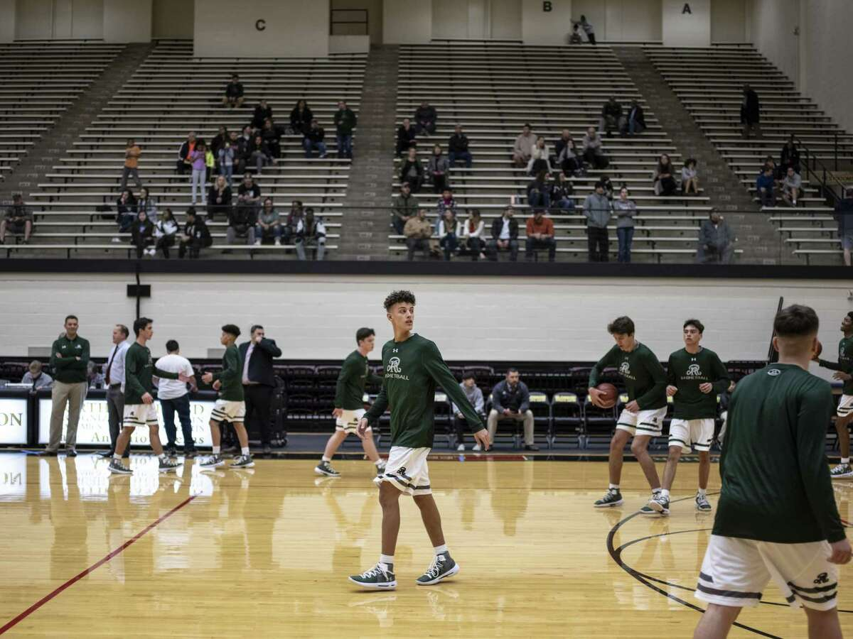 Senior Kaeyel Moore, no. 22, center, warms up with his teammates as he returns to the basketball court for the Reagan High School Rattlers on Monday, November 12, 2018. Moore suffered a cardiac arrest on the practice gym 10 months ago. Head coach John Hirst said that it's good to have him back.