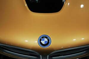 The hood of a 2019 BMW i8 Roadster is seen during the 2018 Seattle International Auto Show at the CenturyLink Field Event Center, Monday, Nov. 12, 2018. The show, which ran from Nov. 9-12, included over 500 2019 model cars from foreign and domestic companies, as well as older classic exhibition cars.