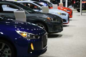 Hyundai Elantra GTs are lined up during the 2018 Seattle International Auto Show at the CenturyLink Field Event Center, Monday, Nov. 12, 2018. The show, which ran from Nov. 9-12, included over 500 2019 model cars from foreign and domestic companies, as well as older classic exhibition cars.