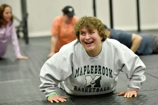 Madison, Connecticut, November 12, 2018: Vista Life Innovations student Andrea of Westbrook, left, exercisea at Hammonasset (CQ) CrossFit of Madison. Hammonasset (CQ) CrossFit has been working with Vista Life Innovations students for the past 3-years teaching them adaptive CrossFit and inspiring the most sedentary members to become more active.