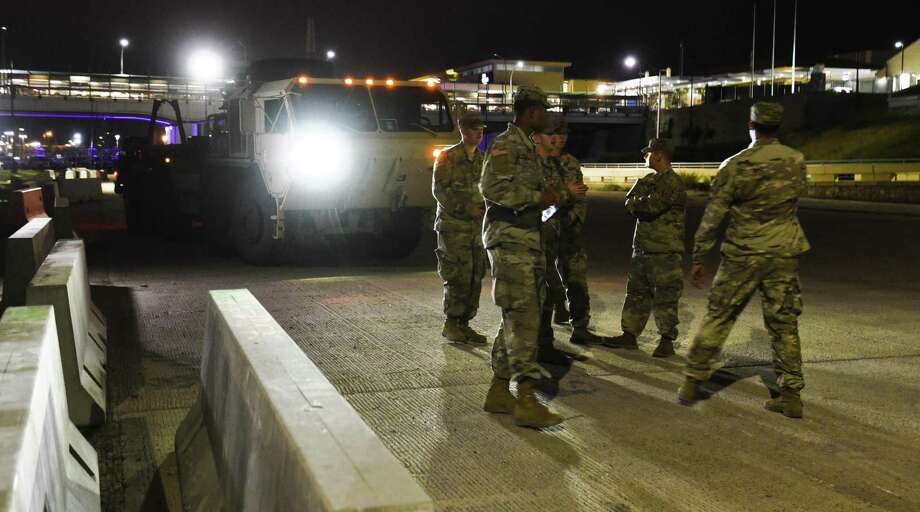 Members of the U.S. Military arrive with Palletized Load Systems at the banks of the Rio Grande in Laredo on Saturday as they drop off Jersey barriers between the Gateway to the Americas International Bridge and Lincoln-Juarez International Bridge. Photo: Danny Zaragoza /Laredo Morning Times / Laredo Morning Times