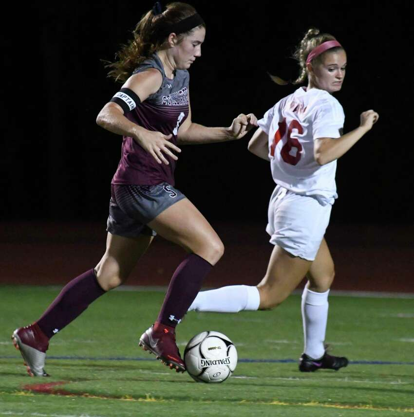 Stillwater's Brooke Pickett moves the ball past Tamarac's Vanessa Baldwin during a game at Stillwater High School on Tues., Sept. 18, 2018, in Stillwater, N.Y. (Jenn March, Special to the Times Union)
