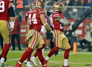 Matt Breida (22) struts in the end zone after scoring a rushing touchdown in the first half as the San Francisco 49ers played the New York Giants at Levi's Stadium in Santa Clara, Calif., on Monday, November 12, 2018.