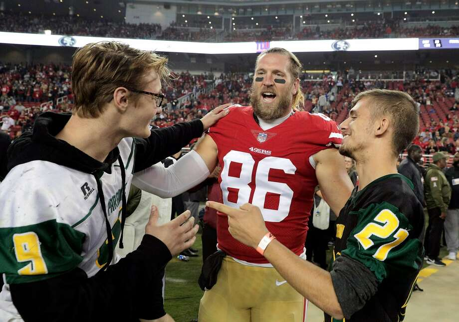 Kaleb Nelson (9) and Austyn Swarts (21) chat with 49ers Kyle Nelson (86) before the national anthem as the San Francisco 49ers played the New York Giants at Levi's Stadium in Santa Clara, Calif., on Monday, November 12, 2018. Photo: Carlos Avila Gonzalez / The Chronicle