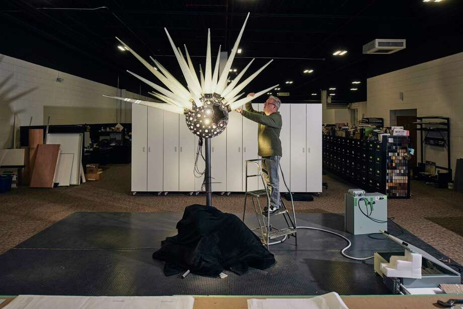 Marcus Poisson, industrial designer and lighting developer, works on the new Swarovski star that will go on top of the Rockefeller Center tree in New York, in Smithfield, R.I., Oct. 31, 2018. Daniel Libeskind's architectural feat — all 900 pounds, 70 spikes, and three million Swarovski crystals of it — will light up the night at Rockefeller Center. (Tony Luong/The New York Times) Photo: TONY LUONG / NYTNS