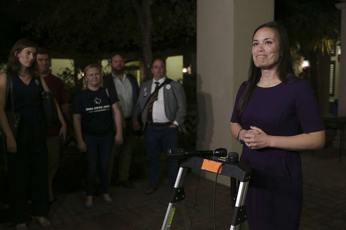 Gina Ortiz Jones speaks to the media after the Bexar County Democratic Party election night watch party at The Herrera Law Firm on Nov. 6, 2018.