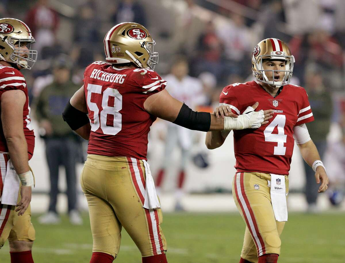 Nick Mullens (4) gets a pat on the chest from Weston Richburg (58) in the second half as the San Francisco 49ers played the New York Giants at Levi's Stadium in Santa Clara, Calif., on Monday, November 12, 2018.