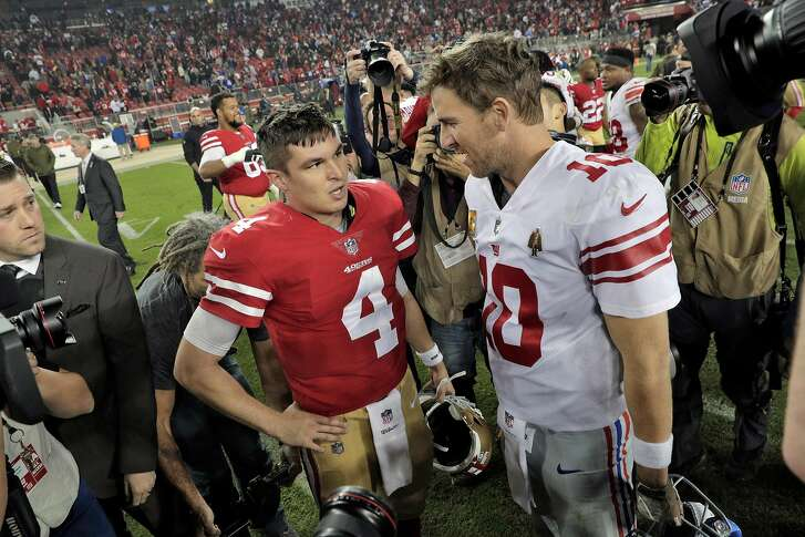 Nick Mullens (4) and Eli Manning (10) chat after the game after the San Francisco 49ers played the New York Giants at Levi's Stadium in Santa Clara, Calif., on Monday, November 12, 2018.