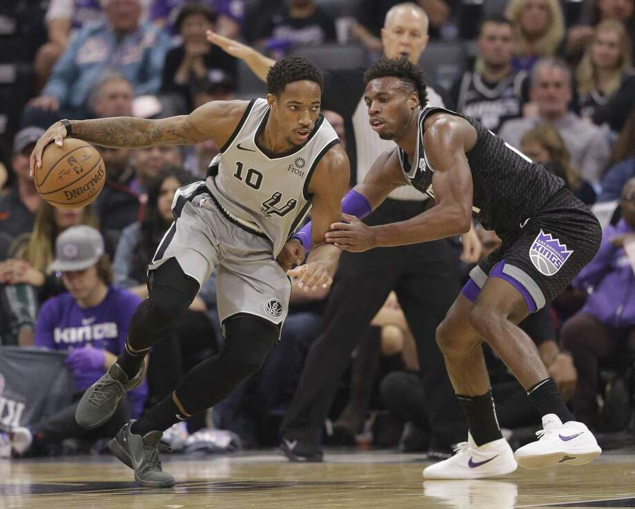 Spurs guard DeMar DeRozan, left, drives against Kings guard Buddy Hield on his way to a team-high 23-point game on Monday night. Photo: Rich Pedroncelli / Associated Press / Copyright 2018 The Associated Press. All rights reserved
