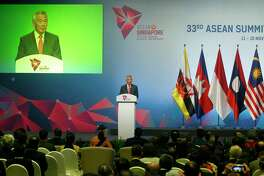 Singapore's Prime Minister Lee Hsien Loong addresses delegates during the opening ceremony for the 33rd ASEAN Summit and Related Summits Tuesday, Nov. 13, 2018, in Singapore. The summit is expected to discuss the South China Sea issue, maritime security and terrorism.