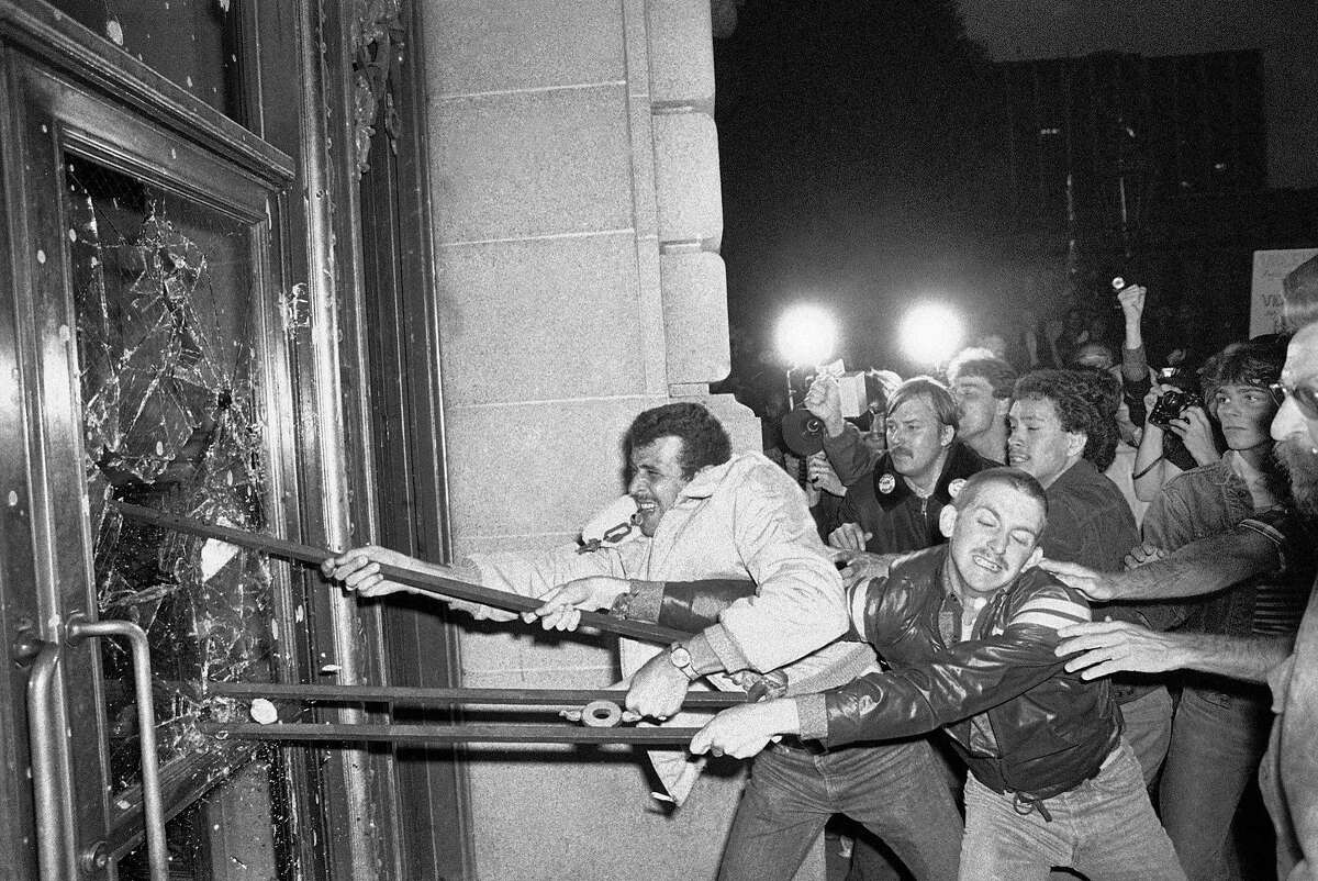 In this May 22, 1979 file photo, demonstrators smash glass out of the front doors of the San Francisco City Hall. Thousands marched to city hall, protesting the voluntary manslaughter conviction of Dan White in the fatal shootings of Mayor George Moscone and city supervisor and gay rights activist Harvey Milk.