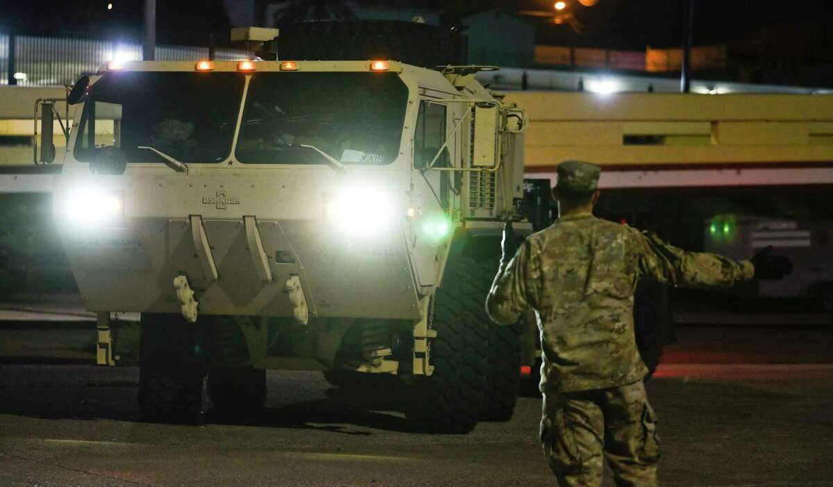 Members of the U.S. Military arrive in Palletized Load Systems at the banks of the Rio Grande in Laredo, TX, on Saturday, Nov. 10, 2018, as they drop off Jersey barriers between the Gateway to the Americas International Bridge and Lincoln-Juarez International Bridge.