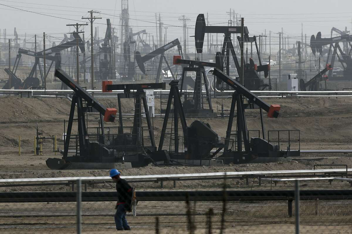 File - This Jan. 16, 2015, file photo shows pumpjacks operating at the Kern River Oil Field in Bakersfield, Calif.
