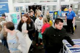 FILE- In this Nov. 23, 2017, file photo shoppers enter a Best Buy looking for early Black Friday deals on Thanksgiving Day in Bowling Green, Ky. A solid 70 percent of Americans plan to shop on Black Friday this year, according to a recent NerdWallet study conducted by The Harris Poll. (Bac Totrong/Daily News via AP, File)