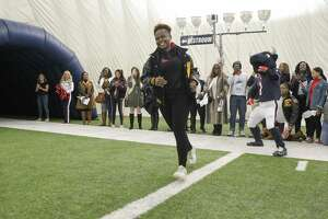 Pascaline Chuma is introduced before members of the media and scholar athletes played flag football game in the Texans Houston Methodist Training Center Monday, Nov. 12, 2018, in Houston.