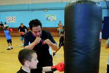 Mayor David Cassetti kicks off the Pinky Silverberg Boxing Club training program for boys and girls between ages 6 and 13 at the Ansonia Armory on North Cliff Street in Ansonia, Conn., on Thursday Sept 1, 2016. The children are learning the basics of boxing for exercise and self-defense. The weekly training will culminate in a Nov. 11th event where the kids will demonstrate their skills and afterwards there will be a set of state sactioned amatuer boxing matches.
