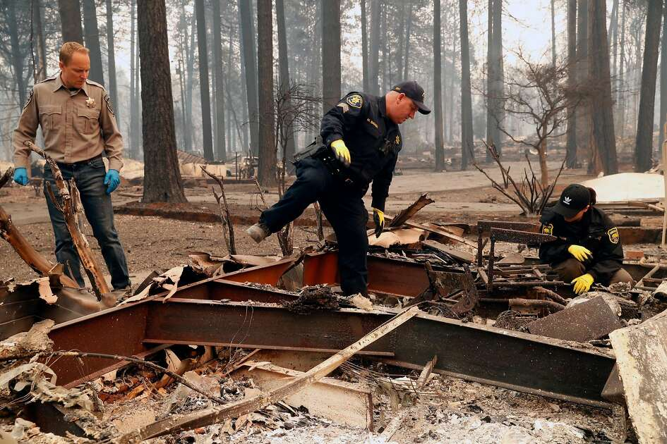 (left to right) Chico Police Chaplin Dan Wysong, Alameda County Sheriff's Dept. Sgt. Howard Baron and Butte County Investigator Tiffany Larson search for victims of the Camp Fire in the Pine Springs Mobile Home Park in Paradise, Calif. on Monday, November 12, 2018. Both Wysong and Larson lost their Paradise homes in the wildfire.