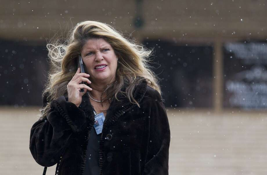 Attorney Mary Van Orman watches as wintery mix falls around her as she walks toward the Montgomery County Courthouse, Tuesday, Nov. 13, 2018, in downtown Conroe. Photo: Jason Fochtman/Staff Photographer