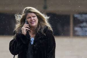 Attorney Mary Van Orman watches as wintery mix falls around her as she walks toward the Montgomery County Courthouse, Tuesday, Nov. 13, 2018, in downtown Conroe.