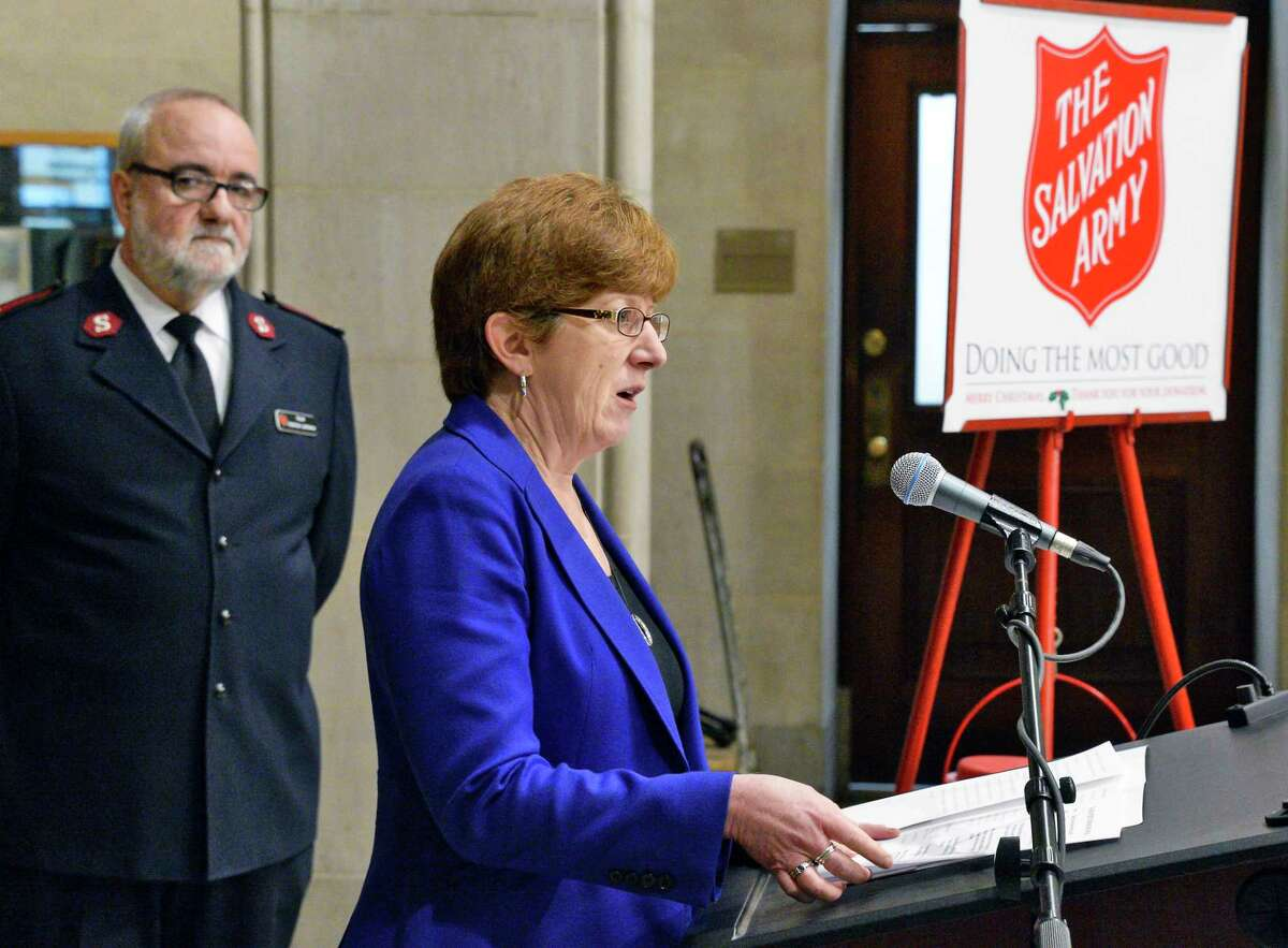 Mayor Kathy Sheehan and Major Federico Larrinaga, left, of the Salvation Army of Albany during a ceremony at City Hall to launch their Annual Red Kettle Campaign Tuesday Nov. 13, 2018 in Albany, NY. (John Carl D'Annibale/Times Union)