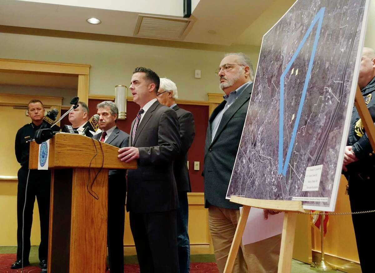 Chair of the Albany County Legislature, Andrew Joyce, at podium, talks about poor cellular service in areas of Colonie during a press conference at the Shaker Road Loudonville Fire Department on Tuesday, Nov. 13, 2018, in Colonie, N.Y. (Paul Buckowski/Times Union)