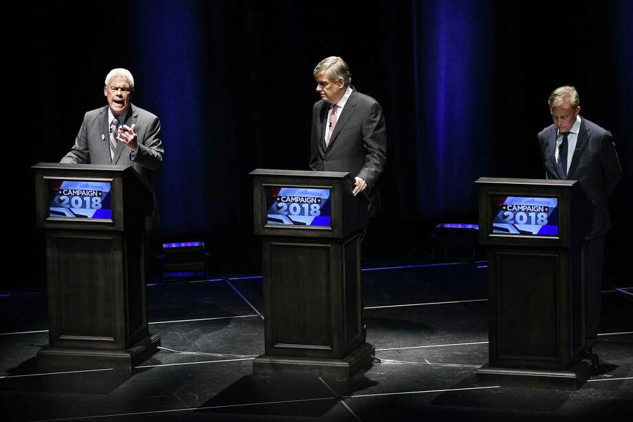 Independent candidate Oz Griebel, left, spoke, while Republican candidate Bob Stefanowski, center, and Democratic candidate Ned Lamont, right, listened during a recent debate in the governor's race. Sacred Heart University on Wednesday night will host a discussion of the race. It will begin at 7 in the Martine Forum, 5401 Park Avenue in Fairfield, and is free and open to the public. Photo: Jessica Hill / Associated Press / Copyright 2018 The Associated Press. All rights reserved
