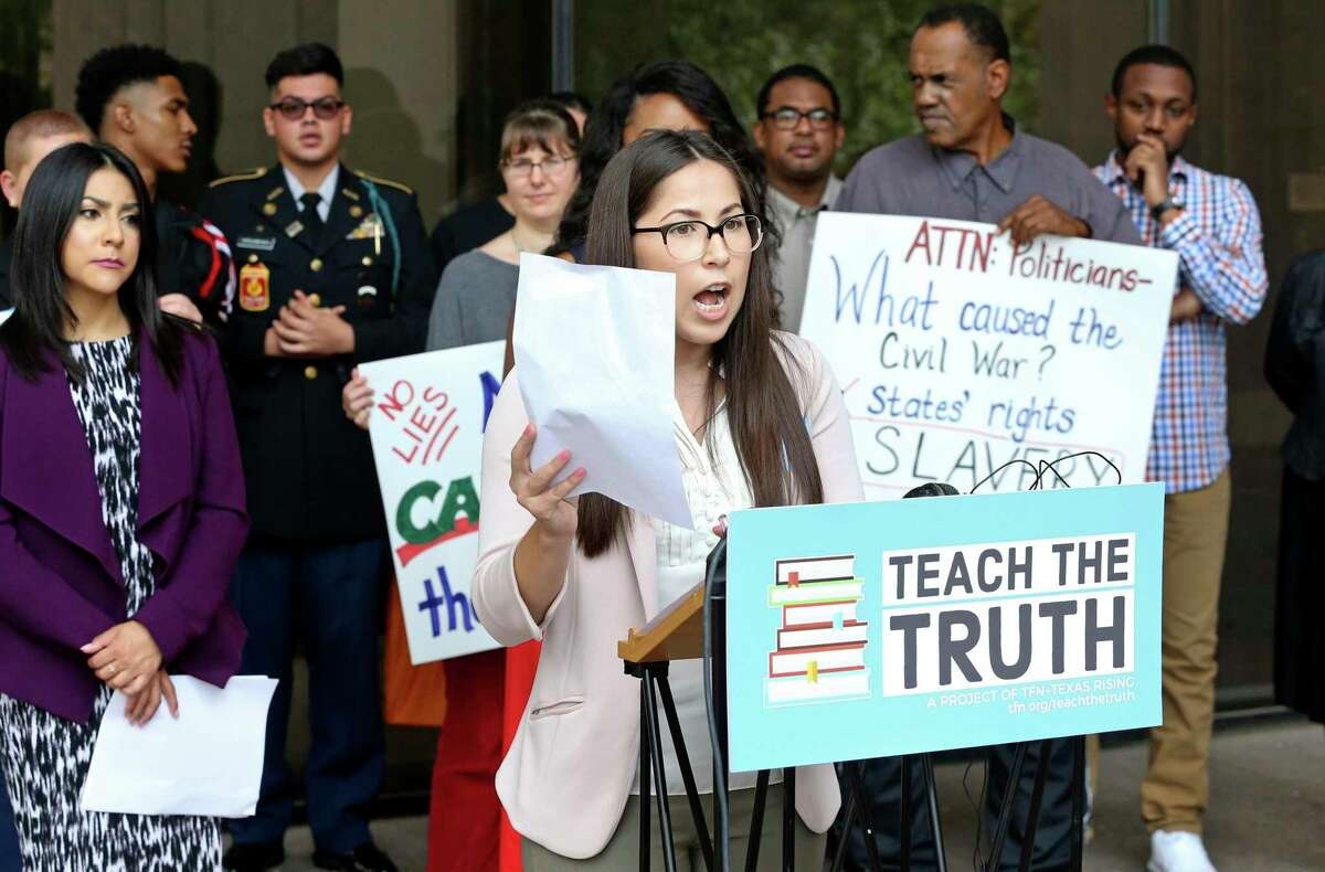 Carisa Lopez, representing the Texas Freedom Network, delivers her message to the media outside after speaking to the State Board of Education as it hears comments on proposed changes to the state's social studies curriculum at its meeting in Austin on September 11, 2018.