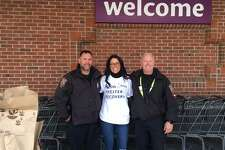 Westport Police Officers Mark Grasso, left, and Scott Thompson, right, stand alongside Anna Rycenga, a local resident during the Holiday Food Drive Nov. 10 outside Stop & Shop, 1790 Post Road East. The trio helped collect more than two tons of food and $1,750 cash for the Bridgeport Rescue Mission.