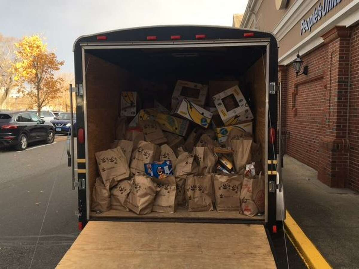 A truck loaded with more than two tons of food stands outside the Stop & Shop at 1790 Post Road East Nov. 10. The cargo will be delivered to the Bridgeport Rescue Mission and was collected during the annual Holiday Food Drive in which Westport police participated.