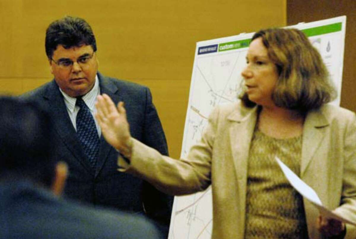 Former neighbor and prosecution witness Marshall Gokey, at left, is questioned by defense attorney Laurie Shanks Wednesday August 2, 2006.
