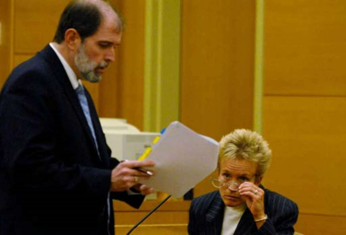 Defense witness Dr. Mary Dombovy is cross examined by Chief Assistant District Attorney Michael P. McDermott Monday August 7, 2006.