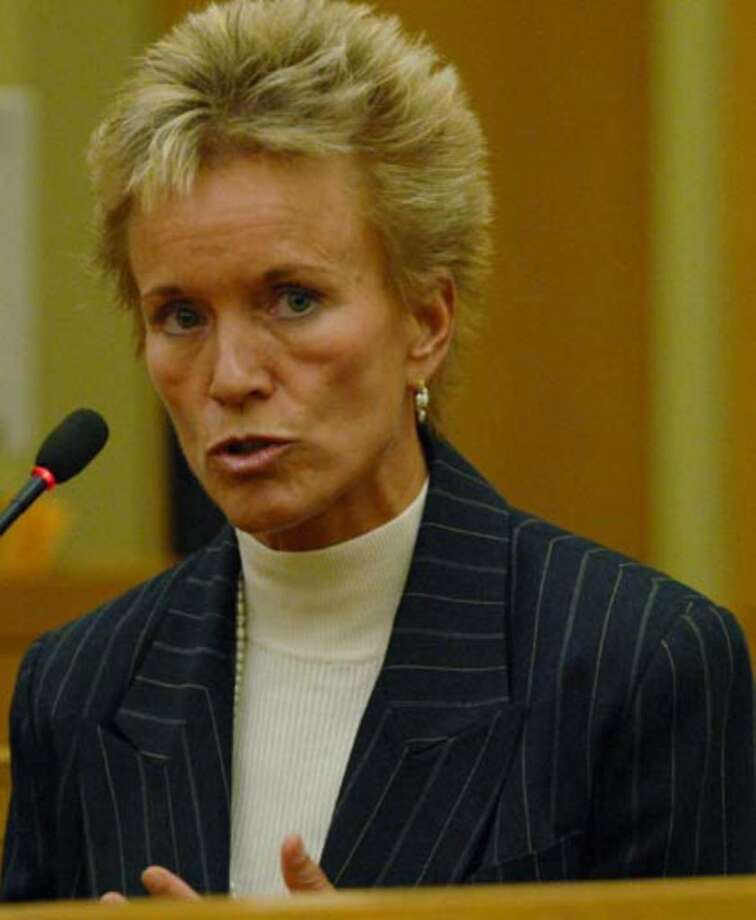 Dr. Mary Dombovy responds to questioning by attorney Laurie Shanks Monday August 7, 2006. Photo: Michael P. Farrell