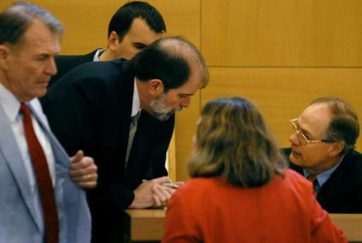 Lawyers meet with Judge Jeffrey G. Berry prior to his charges to the jury in the Christopher Porco trial Thursday, August 10, 2006.
