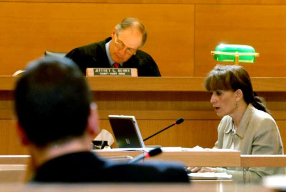 Senior Court Reporter Lucille Kester, right, reads back testimony for the jury in deliberation Thursday August 10, 2006. Photo: Michael P. Farrell