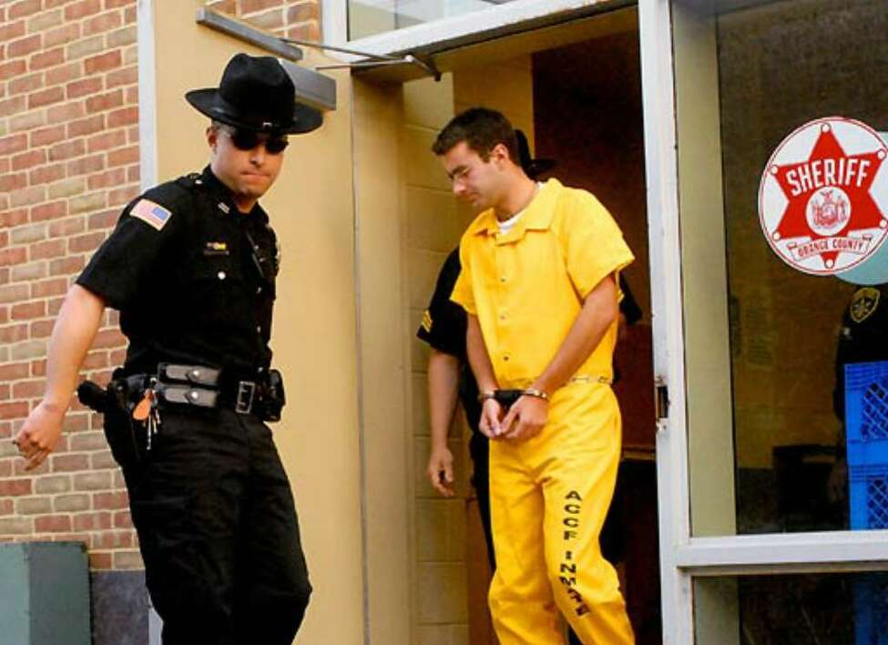 Christopher Porco is led out of the Orange County Courthouse in Goshen after being found guilty of second-degree murder and assault Thursday. (Michael P. Farrell / Times Union)