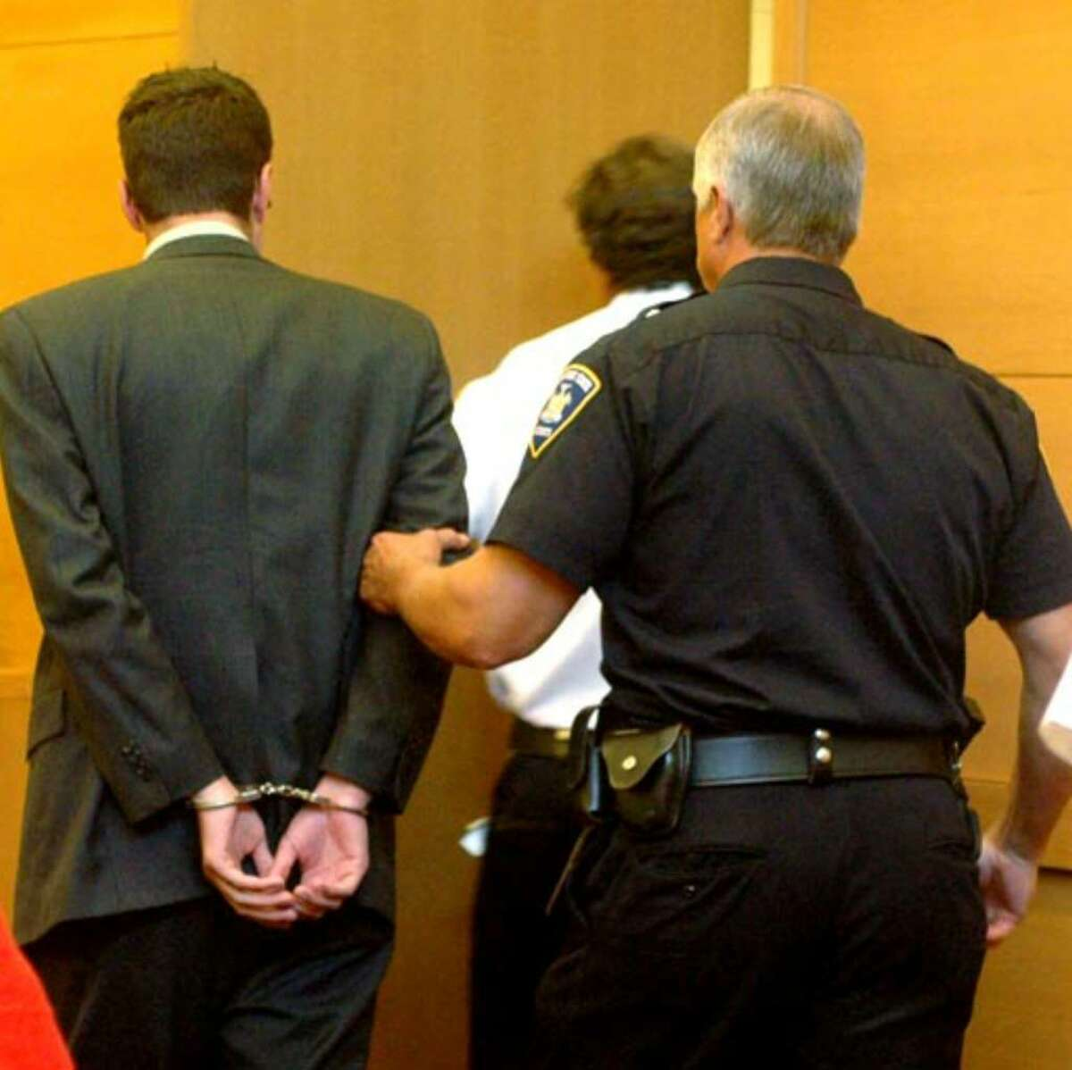 Christopher Porco is taken into custody, Thursday August 10, 2006.