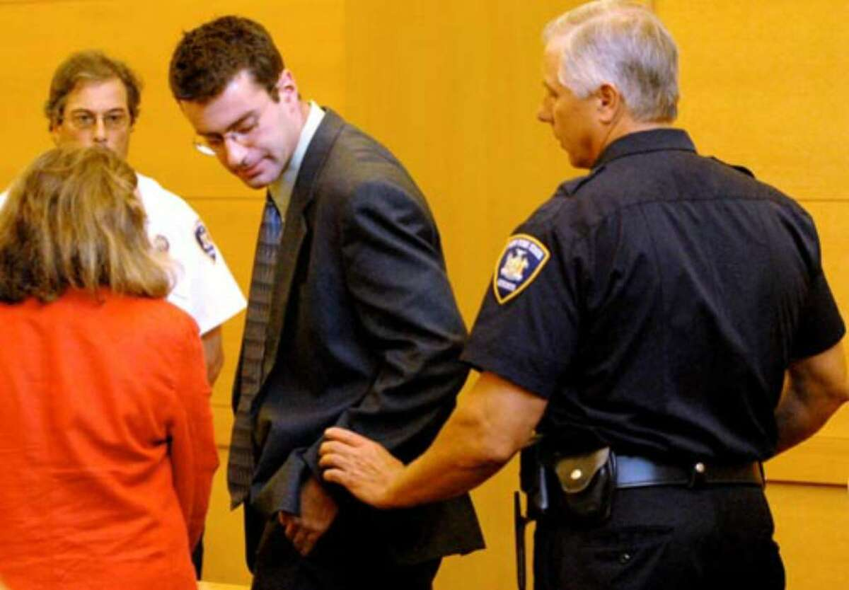 Christopher Porco is taken into custody after being found guilty on Thursday August 10, 2006.