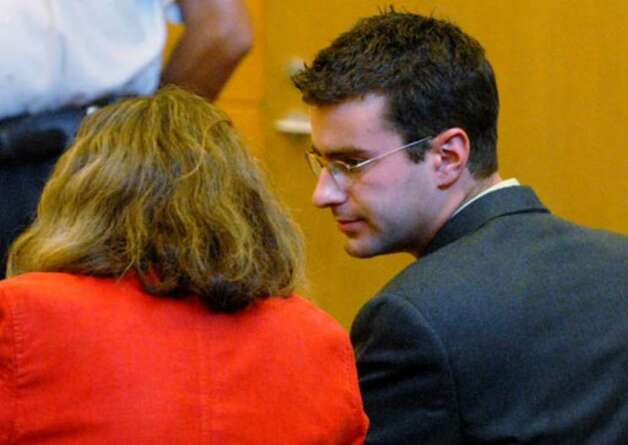 Christopher Porco talks with attorney Laurie Shanks before being taken into custody and after being found guilty on Thursday August 10, 2006. After the verdict was announced, Porco leaned over to her and told her ``Thank you for everything.'' Photo: Michael P. Farrell