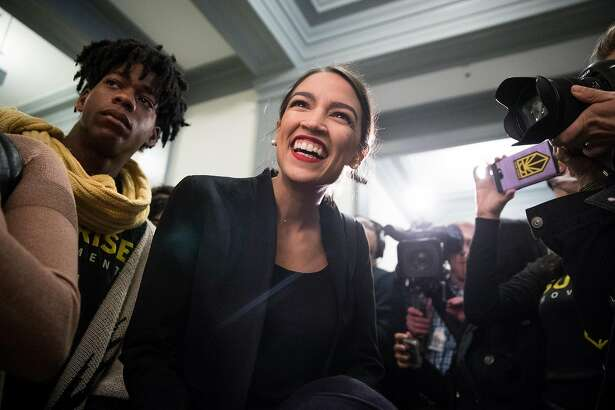 Alexandria Ocasio-Cortez, the congresswoman-elect from New York, prepares to speak to activists with the Sunrise Movement protesting in the offices of House Minority Leader Nancy Pelosi (D-Calif.) on Capitol Hill, in Washington, Nov. 13, 2018. (Sarah Silbiger/The New York Times)