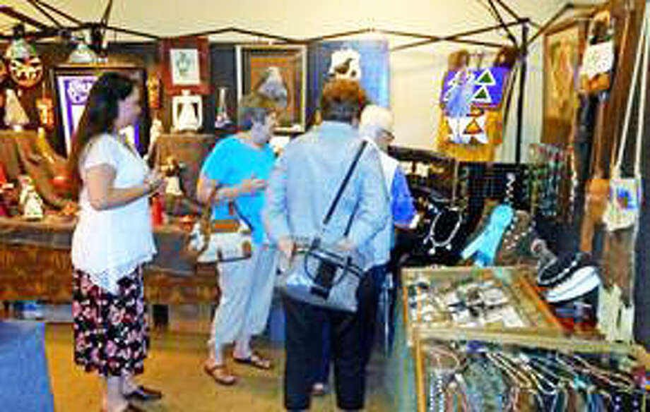 Shoppers browse handmade goods at a previous Holiday Native American Market Days event at Cahokia Mounds Interpretive Center in Collinsville. This year's event features nearly 40 artists and will run on Thanksgiving weekend from noon to 5 p.m. on Friday, Nov. 23, and from 9 a.m. to 5 p.m. on Saturday and Sunday, Nov. 24 and 25. Photo: For The Intelligencer