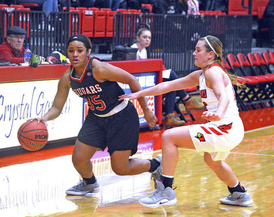 SIUE freshman Mikala Hall, left, dribbles past an Illinois State defender during Sunday's season opener at Vadalabene Center. Photo: Scott Marion/Intelligencer
