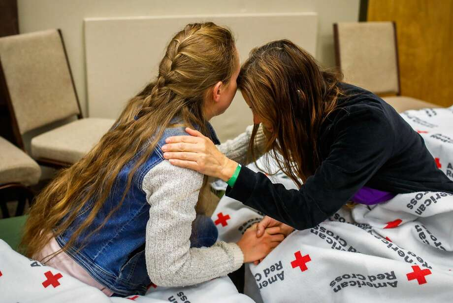 Evacuees Heidi Bigelow (right) and daughter Marina Joy (left), 18, who fled their home in Paradise, take a moment to reflect at the Red Cross shelter in Chico. Photo: Gabrielle Lurie / The Chronicle