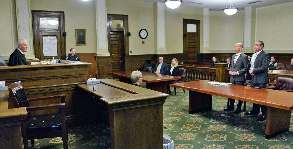 Acting NYS Supreme Court Judge Peter Lynch, left, presides over sentencing of former Troy police officers Ron Epstein, right, in Rensselaer County Court for sentencing Tuesday Nov. 13, 2018 in Troy, NY. Epstein's lawyer is Michael Koenig. (John Carl D'Annibale/Times Union)