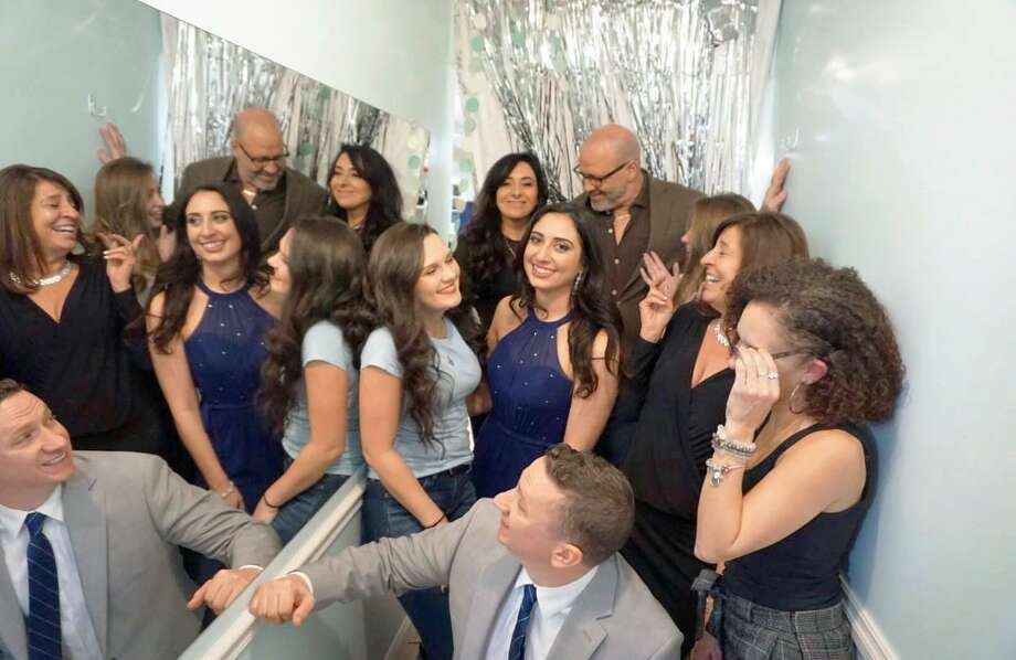 Abbie Paklos, center, in royal blue, bought and moved The Wedding Dress bridal boutique to a new location in Portland, just down the street. Photo: Contributed Photo