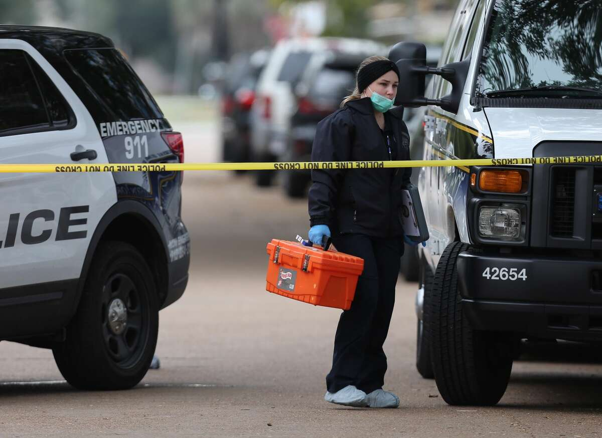HPD and Houston Forensic Science Center officials investigate the scene where a shooting left one Lamar High School student dead near the intersection of Bammel Lane and Philfall Street on Tuesday, Nov. 13, 2018, in Houston.
